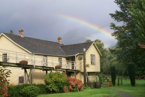 cottage from yard with rainbow 01 13 2014